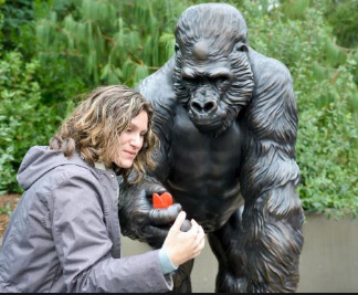 Jodi with the statue of Ivan at Point Defiance Zoo & Aquarium in Tacoma, Washington